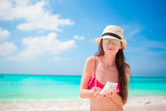 Portrait of beautiful woman with a big seashell Stock Photography