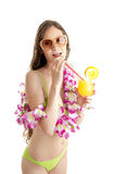 Portrait of beautiful woman in bikini wearing flower lei garland. Stock Photo