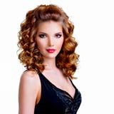 Portrait of beautiful woman in black dress. stock photo