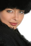 Portrait of a beautiful woman in black fur cap Stock Photo