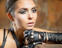 Portrait of beautiful woman. In a black gloves Royalty Free Stock Photo