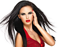 Portrait of  the beautiful woman with  black hairs and red lips Royalty Free Stock Image