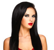 Portrait of  the beautiful woman with  black hairs and red lips Royalty Free Stock Photography