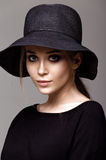Portrait of a beautiful woman in black hat Stock Photo