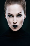 Portrait of a beautiful woman, with black lips Royalty Free Stock Photography
