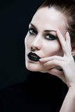 Portrait of a beautiful woman, with black lips. Stock Photo