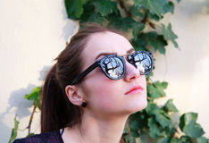 Portrait of beautiful woman in black sunglasses Stock Photography