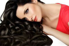 Portrait of Beautiful Woman with Black Wavy Hair. High quality image. Royalty Free Stock Image