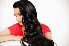 Portrait of Beautiful Woman with Black Wavy Hair. High quality image. Royalty Free Stock Photography