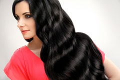 Portrait of Beautiful Woman with Black Wavy Hair. High quality image. Stock Photography