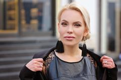Portrait of a beautiful woman with blond hair, outdoors royalty free stock photo
