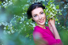 Portrait of beautiful woman in blooming cherry tree garden Stock Photography