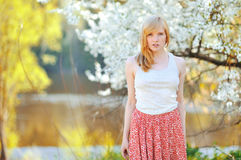 Portrait of beautiful woman in blooming tree in spring. Outdoor Royalty Free Stock Photography