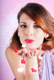 Portrait of a beautiful woman blowing heart kiss Royalty Free Stock Image
