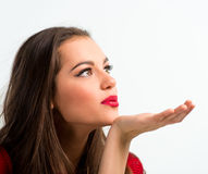 Portrait of a beautiful woman blowing  a kiss Stock Images