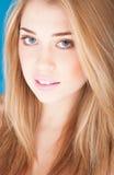 Portrait of beautiful woman on blue background Stock Photo