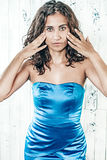 Portrait of a beautiful woman in blue dress. Girl in a blue evening dress Stock Photo