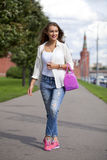 Portrait of a beautiful woman in blue jeans Royalty Free Stock Photography