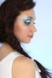 Portrait of beautiful woman with blue make-up Stock Photography