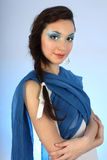 Portrait of beautiful woman with blue make-up Stock Image