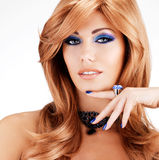 Portrait of a beautiful woman with blue nails, blue makeup Royalty Free Stock Photography