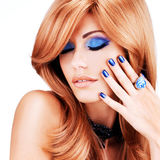 Portrait of a beautiful woman with blue nails, blue makeup. And  long red hairs  on white  background Royalty Free Stock Photography