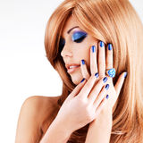Portrait of a beautiful woman with blue nails, blue makeup. And red hairs  on white  background Royalty Free Stock Image