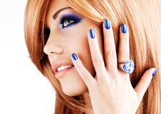 Portrait of a beautiful woman with blue nails, blue makeup Stock Photography