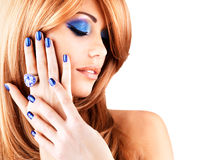 Portrait of a beautiful woman with blue nails, blue makeup. And red hairs  on white  background Stock Photos