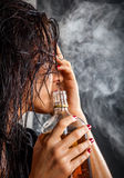 Portrait of beautiful woman with bottle of alcohol drink Royalty Free Stock Photos