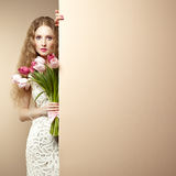 Portrait beautiful woman with bouquet of flowers Stock Image