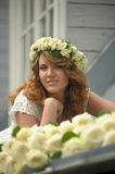 Portrait of a beautiful woman with a bouquet of white roses Stock Images