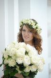 Portrait of a beautiful woman with a bouquet of white roses Royalty Free Stock Photos
