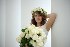 Portrait of a beautiful woman with a bouquet of white roses Stock Photos