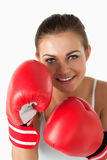 Portrait of a beautiful woman with boxing gloves Stock Photo