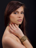 Portrait of a beautiful woman with bracelet. Portrait of a beautiful young romanian woman with her hand to her face wearing a bracelet stock photography