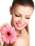 Portrait of beautiful woman with bright make up holding pink daisy in hands Royalty Free Stock Photography