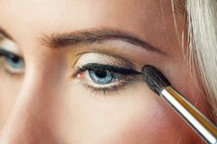 Portrait of beautiful woman with brush for make-up Royalty Free Stock Image