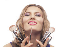 Portrait of beautiful woman with brushes for make-up Royalty Free Stock Image