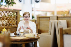Portrait of a beautiful woman in a cafe. Blonde 40-45 years. Stock Image