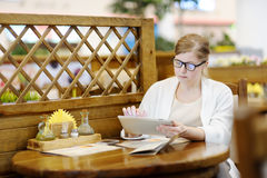 Portrait of a beautiful woman in a cafe. Blonde 40-45 years. Stock Photography