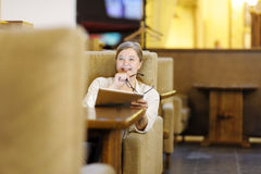 Portrait of a beautiful woman in a cafe. Blonde 40-45 years. Royalty Free Stock Image