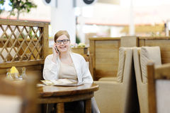 Portrait of a beautiful woman in a cafe. Blonde 40-45 years. Royalty Free Stock Images