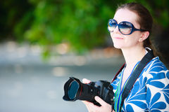 Portrait of beautiful woman with camera Stock Images