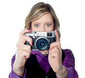 Portrait of a beautiful woman with camera Stock Photos