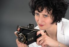 Portrait of a beautiful  woman with a camera Royalty Free Stock Images