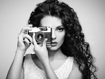 Portrait of beautiful woman with the camera. Girl photographer Stock Photos