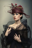 Portrait of beautiful woman in the cap. Portrait of beautiful woman in the brown cap Royalty Free Stock Images