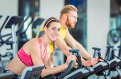 Portrait of a beautiful woman during cardio routine on stationary bicycle stock photo