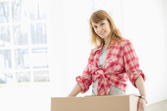 Portrait of beautiful woman carrying cardboard box Stock Images